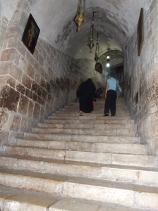 Going up the stairs from a tomb under the church